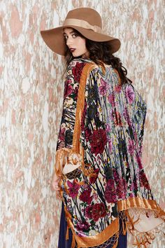 There's pretty, and then there's crazy beautiful-- this one falls into the latter. It's a vintage kimono with a floral velvet burn-out design