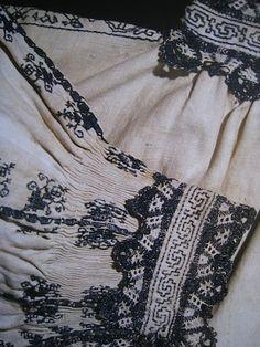 Man's shirt, linen with blue silk embroidery and bobbin lace. Knee-length, late 16th century. From The Textile Museum in Prato. shirtlate16thcprato2.jpg Photo by operafantomet | Photobucket