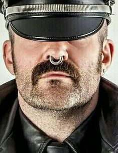 "viciousskkin: "" torturesadist: ""I love how a muir cap hides the eyes, whether it another Master/Owner or sub/slave doing a Master's bidding. Septum piercing are a turn on, but this one is way too small, it needs to be larger. "" WWear LeaTHHer for. Septum Piercing Men, Double Cartilage Piercing, Facial Piercings, Ear Piercings Cartilage, Male Piercings, Tongue Piercings, Moustaches, Emoji, Scruffy Men"
