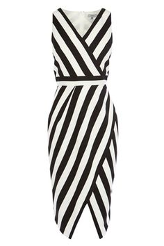 This chic stripe dress is ideal for any occasion this season. The Ishani Stripe Shift Dress features a deep V neckline and a fitted shape, ideal for day to night events. The contrast of monochrome stripes flatter the figure beautifully and adds gorgeous allure. Closing with a back concealed zip, this wrap style dress measures 41.3 inches/105cm from neck to hem. Height of model shown: 5ft 9inches/175cm. Model wears: UK size 10.