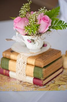Best Ideas for Rustic Wedding Centerpieces Recycle the old and antique . Best Ideas for Rustic Wedding Centerpieces Recycle the old and antique books with tea cups by using them as a c. Vintage Book Centerpiece, Book Centerpieces, Centerpiece Ideas, Teapot Centerpiece, Centerpiece Flowers, Simple Centerpieces, Flowers Decoration, Centrepieces, Spring Wedding Centerpieces