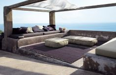 Cushions on concrete wall and pergola