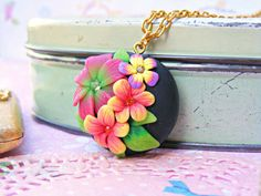 Polymer Clay pendant by Etsy seller Sweetystuff. Made using the appliqué technique, also known as the embroidery technique.