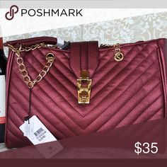 "Wine metallic with gold hardware Handbag with an adjustable strap square in shape beautiful wine color.  Dimensions - 11.5""L x 6""W x 6.5""H Inner bag dimensions - 10""L x 4""W x 6"" Small pouch dimensions - 5""L x 1.5""W x 5""H Gold-tone hardware Faux-leather Interior - 1 zipper pocket and 2 slip pockets Closure - zipper Bags"