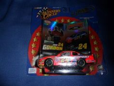 2001 NASCAR Winner's Circle . . . Jeff Gordon #24 Dupont 200 Years Chevy Monte Carlo 1/43 Diecast . . . Double Platinum . . . Includes Collector's Cards by NASCAR. $1.83. 1:43 Scale