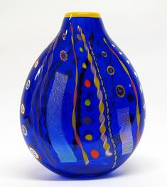 """""""Round Cobalt Abstract vase""""  ~    Ingrid Hanson and Ken Hanson  ~  Dichroic glass joins colorful, handmade cane and murrini on the playfully speckled surface of this blown glass vessel."""