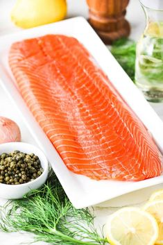 Fresh uncooked salmon fillet on white platter Recipe For Poached Salmon, Baked Salmon Recipes, Party Entrees, Elegant Dinner Party, Lemon Salmon, Hollandaise Sauce, Salmon Dishes, Quick Weeknight Meals, Salmon Fillets