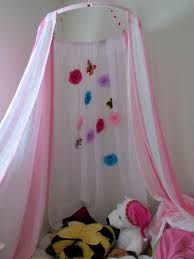 hula hoop, sheer curtains or fun sheets. could also use shower curtain, comes with hoops to attach to hulahoop.