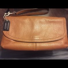 Large Coach wristlet Lightly worn wristlet and wallet in one! Has pockets for cards/money and is big enough to hold a cell phone and lipstick! Great condition minor flaw on inside of over flap! Has original leather coach tag and is super cute when you don't want to carry a purse! Coach Bags Clutches & Wristlets