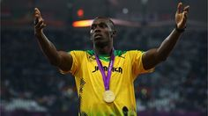 Gold medallist Usain Bolt of Jamaica celebrates during the medal ceremony for the Men's 200m on Day 13 of the London 2012 Olympic Games at Olympic Stadium
