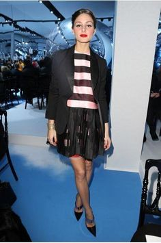 Fashion star Olivia Palermo attended the Dior A/W 2013 show in a dress from the designer's spring 2013 collection, featuring stripes and a fringed hem.