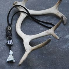 knitted necklace LAVA, black, grey, pebbles, tassel
