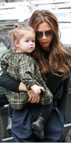 Fashion for kids: Harper Beckham is her mother's daughter! This little fashionista is fetching in a plaid dress with black tights and itty bitty boots.