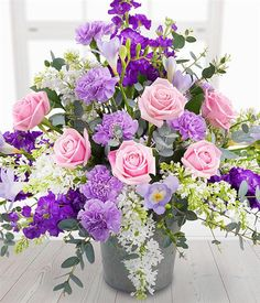 An enchanting flower display exquisitely presented featuring pink Roses, lilacs, purple Stocks with lilac Carnations and delicately fragrant Freesias Easter Flower Arrangements, Funeral Flower Arrangements, Beautiful Flower Arrangements, Funeral Flowers, Flower Centerpieces, Church Flowers, Floral Arrangements, Wedding Flowers, Amazing Flowers