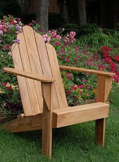 Relax on the handsome and durable All-natural Teak Adirondack Chair; masterfully crafted for comfort and durability.