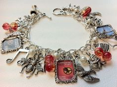 Lots and lots of Hunger Games inspirational DIY charm bracelets. instead of hunger games lets do a charms that remind us of something we completed in out buckett list