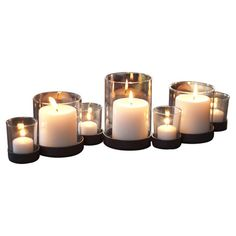 Set of 7 indoor/outdoor handcrafted iron and glass hurricanes.  Product:  7-Piece candleholder setConstruction Mater...