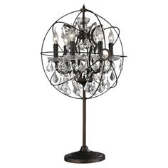 Showcasing an armillary-inspired silhouette and crystal drop accents, this rust-finished table lamp looks elegant flanking your sofa or placed next to the be...