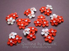1,5mm hand cut quill paper. gloss - water based varnish. Quilled Martisoare Flowers
