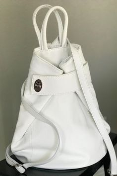 Great hands-free backpack for your weekend. Thick quality Italian pebbled leather with a small zip wall pocket outside and inside plus 2 handy slip pockets that fit a cell phone perfectly. Extra secure with zip closure and turn lock. Secure front strap to the back to make a square tote. Great travel bag. #womenbackpack #backpackbags #madeinitaly #pursesandbags #leatherhandbags #leatherbackpack #backpackforwomen #travelbags #travelcarryon #carryonbag #italianleatherbag #pursesandbags Leather Backpack Purse, Backpack Bags, Italian Leather Handbags, How To Make Handbags, Stitching Leather, Purses And Bags, Backpacks, Shoulder Bag, Travel Bag