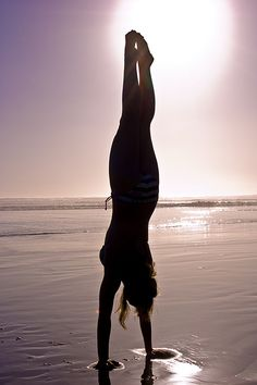 XII. Sometimes the best thing to do is to just hang out at the beach. Handstand Pose (Downward-Facing Tree)