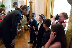 President Barack Obama greets young reporters at the Kids' State Dinner in the East Room of the White House, July 9, 2013