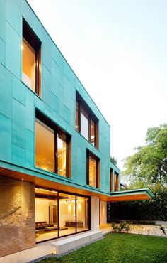 Patina-aged copper facade. The Green House, K2LD Architects