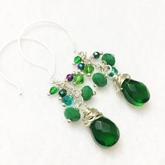 A personal favorite from my Etsy shop https://www.etsy.com/listing/257731784/hand-wrapped-wire-earrings-with-emerald