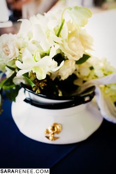 Military Wedding? Beautiful All White Flowers with Orchids, Spray Roses and Lilies Arranged in a Military Cap