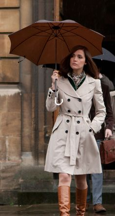 Rose Byrne's trench coat and camel boots in X-Men First Class.