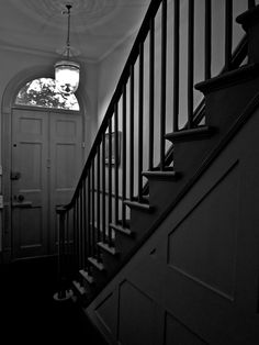 The entrance and steep, narrow staircase in Wentworth Place