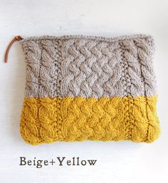 yellow and beige knit purse