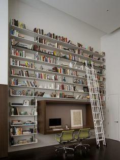 Combo library / office. Floor to ceiling bookshelves, ladder, wall desk // love that desk.