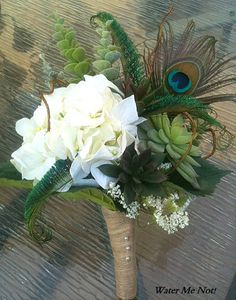 Gorgeous idea for bouquet. Hydrangeas, succulents or other light green filler/buds, and a peacock feather. Twine-wrapped stems. Wear all-white dress?