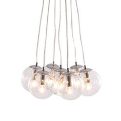 With this set of seven glowing orbs, your hanging lamp will be the decorative centerpiece of your kitchen. Fixed to a chrome base, the lamp hangs to beautifully illuminate your dining area.  Find the Cluster Ceiling Lamp, as seen in the The Bohemian California Beach Lodge Collection at http://dotandbo.com/collections/the-bohemian-california-beach-lodge?utm_source=pinterest&utm_medium=organic&db_sku=ZUO0022
