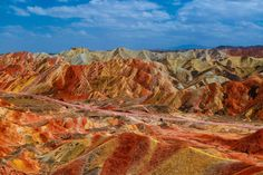 """DANXIA COLORED MOUNTAINS 228 - These were rather lucky shots, this area is quite dry, it only rains ¾ times a year, but by chance there was an heavy rain the previous night, so the next day the colors were exceptionally vibrant. The Zhangye Danxia landform is also known as the """"China's rainbow mountains"""". This 400-square-kilometer attraction is located in in Linze and Sunan counties in Gansu Province in central north China.  The formation of Zhangye Danxia Landform dates back to 6 million…"""