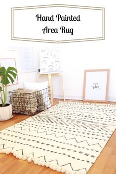 Love this style area rug and love that it comes with rubber mat underneath. White area rug | floor rugs | carpet | minimalist rug | black and white rug | white rug #ad