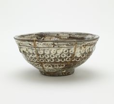 Buncheong Bowl, used in Japan as a Tea Bowl. Joseon period, 15th century. Stoneware with white inlay under transparent glaze; gold lacquer repairs.  5.9 x 13.2 cm. Freer Gallery of Art