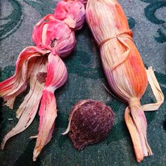 Traditional Sandia Puebloan sweets. Ground whole wheat mixed with piloncillo (Mexican unrefined sugar cane and agave) then molded into balls or small logs, wrapped with corn husks, then baked. MUCH yummyness, and not overly sweet either!