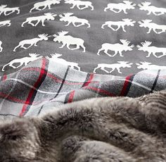 "flannel bedding in a moose motif paired with faux fur. for the coziest winter dent. <a class=""pintag searchlink"" data-query=""%23rhbabyandchild"" data-type=""hashtag"" href=""/search/?q=%23rhbabyandchild&rs=hashtag"" rel=""nofollow"" title=""#rhbabyandchild search Pinterest"">#rhbabyandchild</a>"