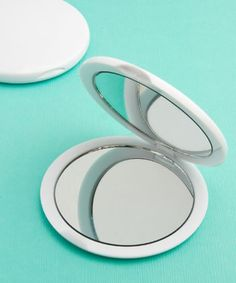 Perfectly Plain Collection Mirror Compact Favors With Fashioncraft's Perfectly Plain Collection mirror compact favors, your guests are sure to reflect well on your happy day. http://www.favorfavorbaby.com/p-6705.htm
