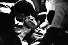 Presidential candidate Robert F. Kennedy lies on the floor at the ambassador hotel in Los Angeles, moments after he was shot in the head