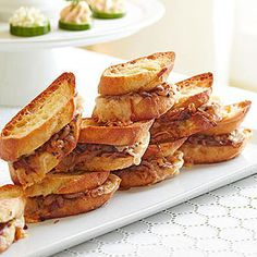 French Onion Sliders - These totally indulgent sliders pack all the flavor of French onion soup into a tidy little sandwich.
