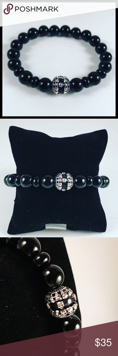 Men 10mm black onyx skull black cz bead bracelet Men beaded bracelet. Fits most , 7.5 to 8.5 inch wrist . Handmade by me , never worn by anyone. Made with 10mm black Onyx gemstones beads . White gold plated skull charm with black cubic zirconia . I ship fast !!✈️ Bundle and save !! ( 10 % off bundles ) . Any questions let me know . No transactions outside Poshmark!! Accessories Jewelry