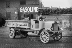 Grove Lime & Coal Company in front of a building sign that reads Gasoline