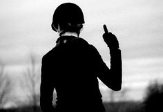 Only appropriate response to someone cantering too close to you in a flat class.