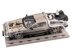 This De Lorean LK Diecast Model Car from Back To The Future Part 3 is Silver and features working wheels and also opening doors. It is made by Vitesse and is 1:43 scale (approx. 9cm / 3.5in long).  ...