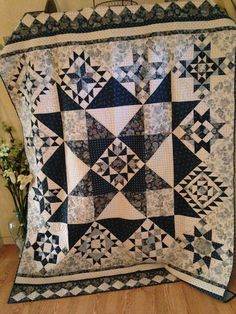 I finally finished the quilts!  This past years Designer Mystery Block of the Month from Fat Quarter Shop was made with Edyta Sitar's (Laund...