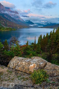 Standing Still    St Mary's Lake at sunrise in Glacier National Park Montana just as storm clouds clear.