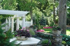 Love everything about this. The pergola. The lush woods.  The picket fence. The stone wall.  All gorgeous!